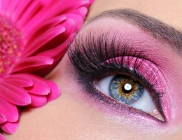 Woman eye with pink make-up and flower